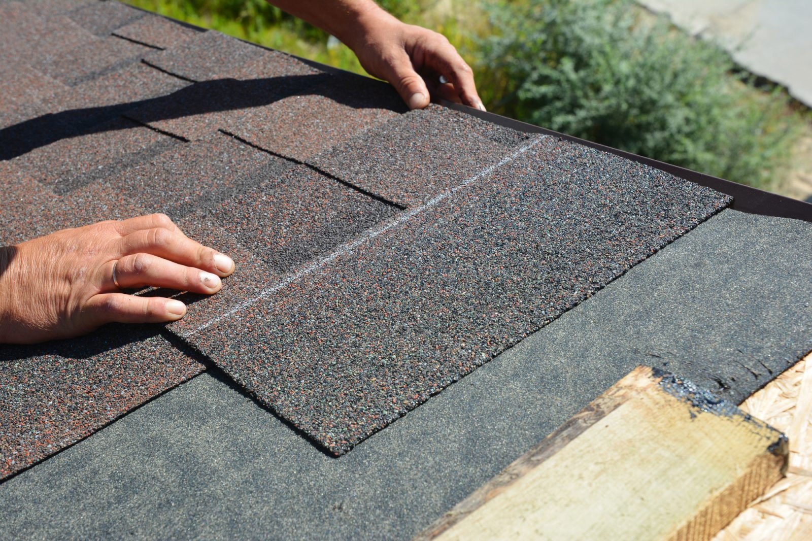 asphalt shingles installation roofer contractor installing asphalt shingles on house roofing construction