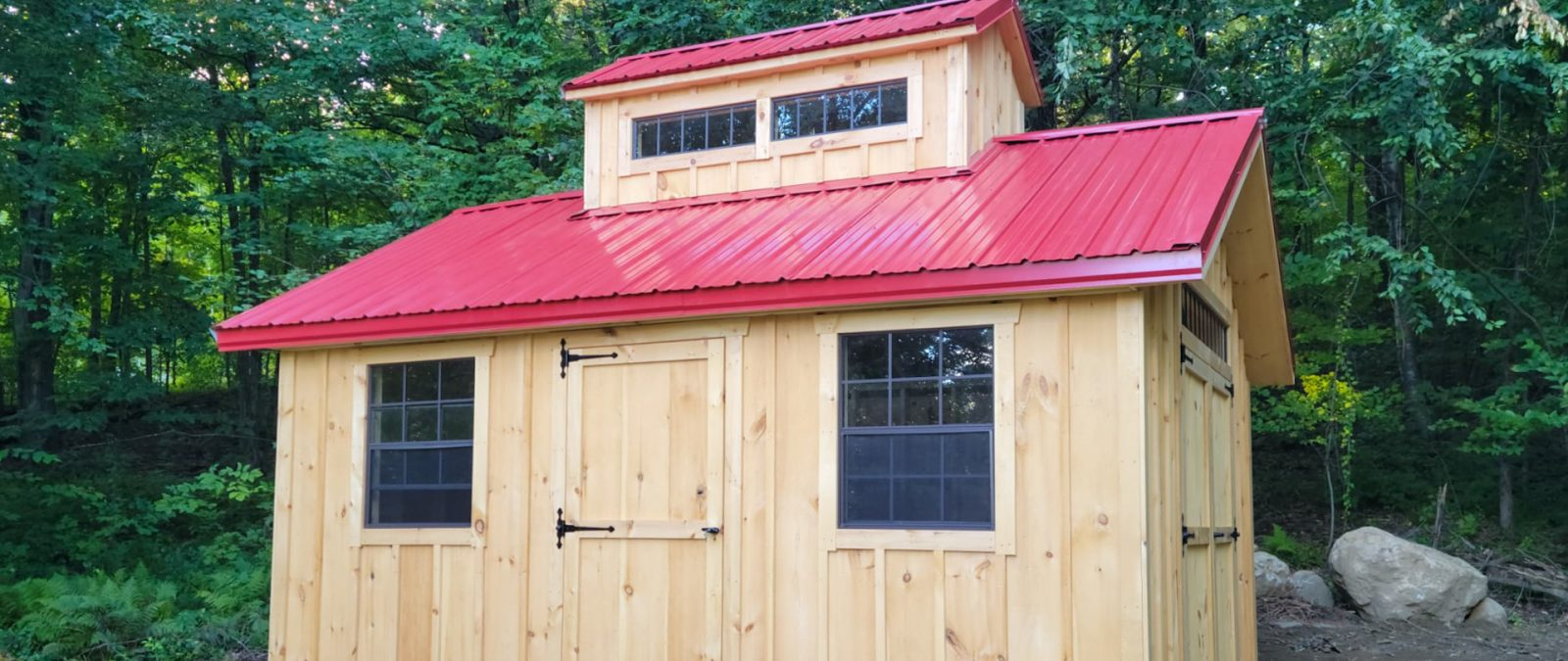 unique shed with metal roof