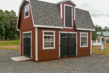 2 story shed with black doors