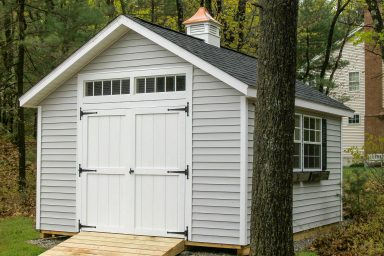 country style shed with cupola
