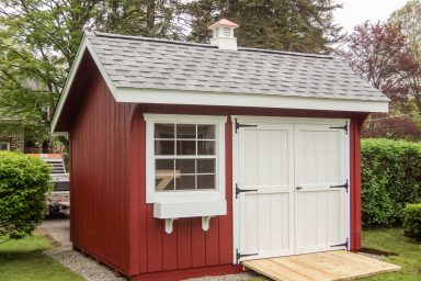 red quaker shed with ramp