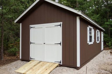 brown new england ranch shed with ramp