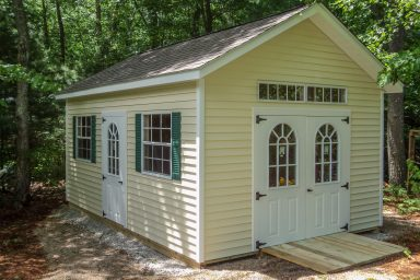 new england ranch shed with fiberglass doors
